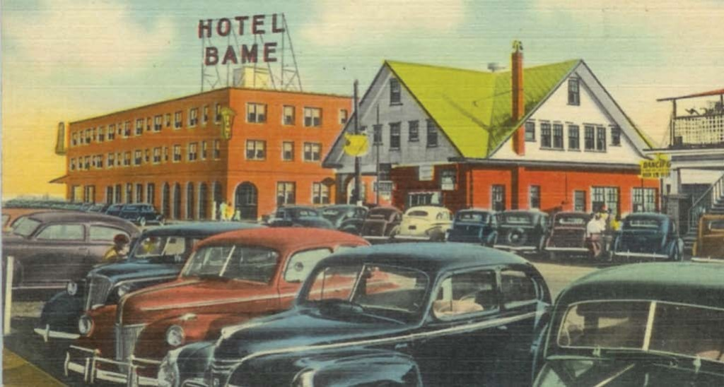 """This postcard shows the Hotel Bame, rebuilt in 1941, with the Bame Esso Service Station and Grocery next door. The station and grocery was run by J. C. """"Mike"""" Bame. It started as just a station, later they added the grocery store and a second story with rooms to rent. Eventually another two story building was added to the back that housed apartments. This building still stands on Cape Fear Blvd. and was most recently used as the Sterling Craft Mall."""